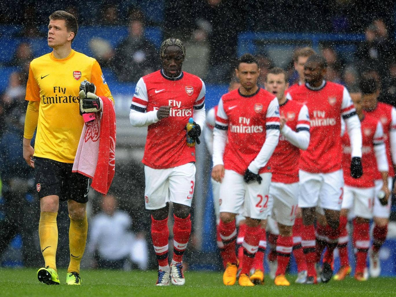 Arsenal walk out onto the pitch against Chelsea