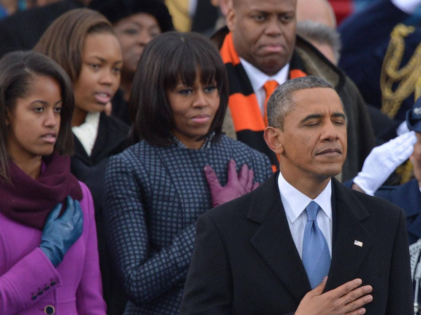 Barack Obama, First Lady Michelle Obama  (2nd left) and Malia (left) listen to Beyonce sing during the inauguration ceremonial swearing-in