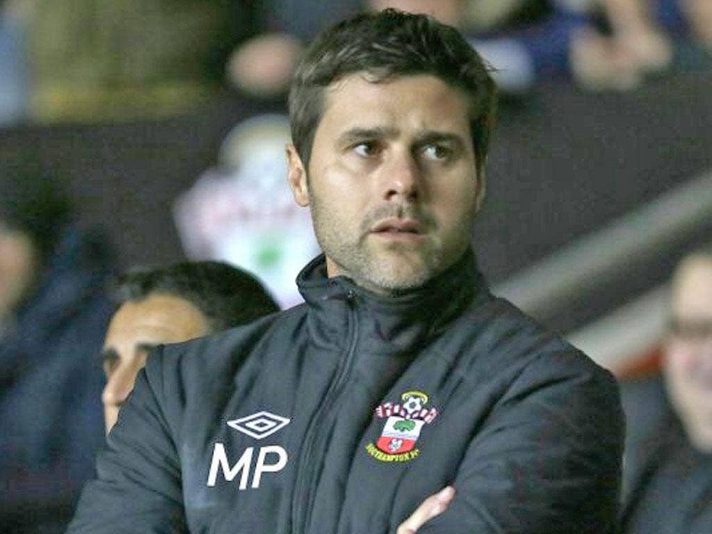 Southampton's new manager Mauricio Pochettino looks out from the technical area prior his teams game against Everton