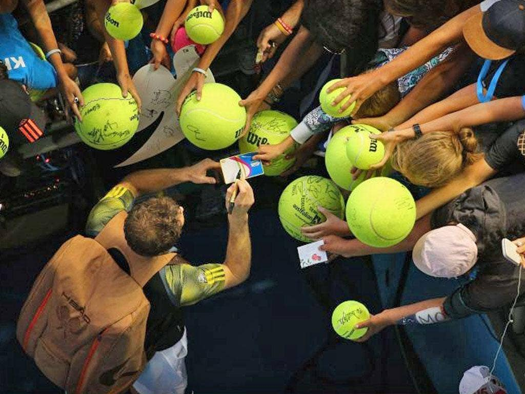 Andy Murray is besieged by autograph hunters at the Australian Open