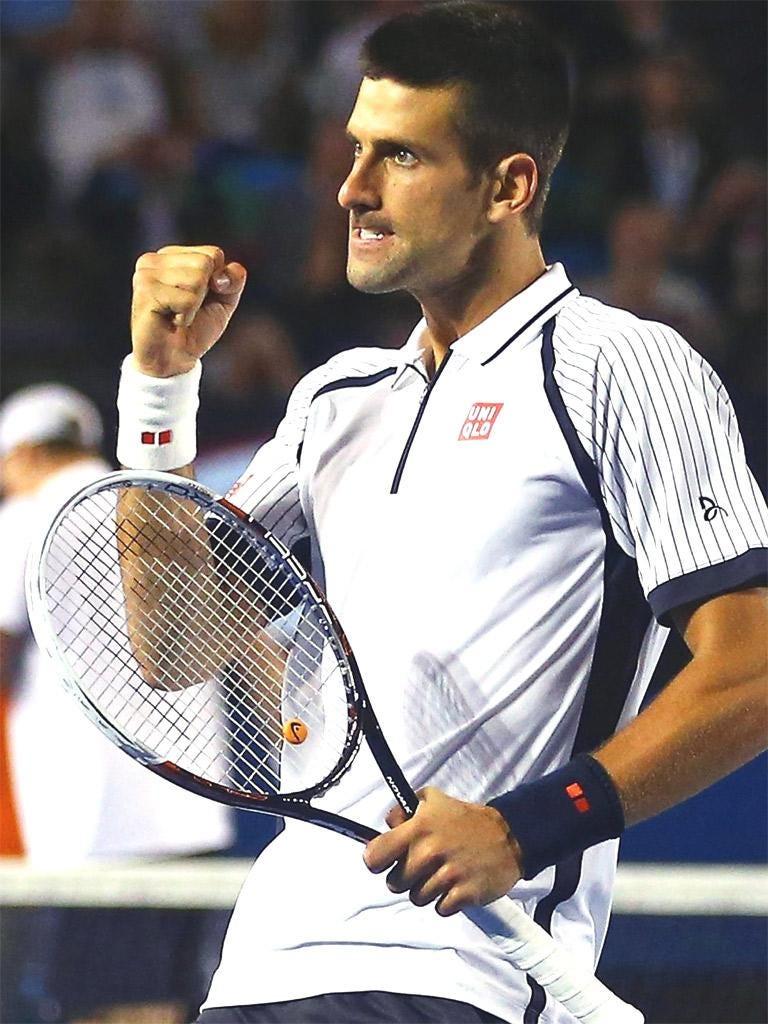Novak Djokovic celebrates his win over Tomas Berdych
