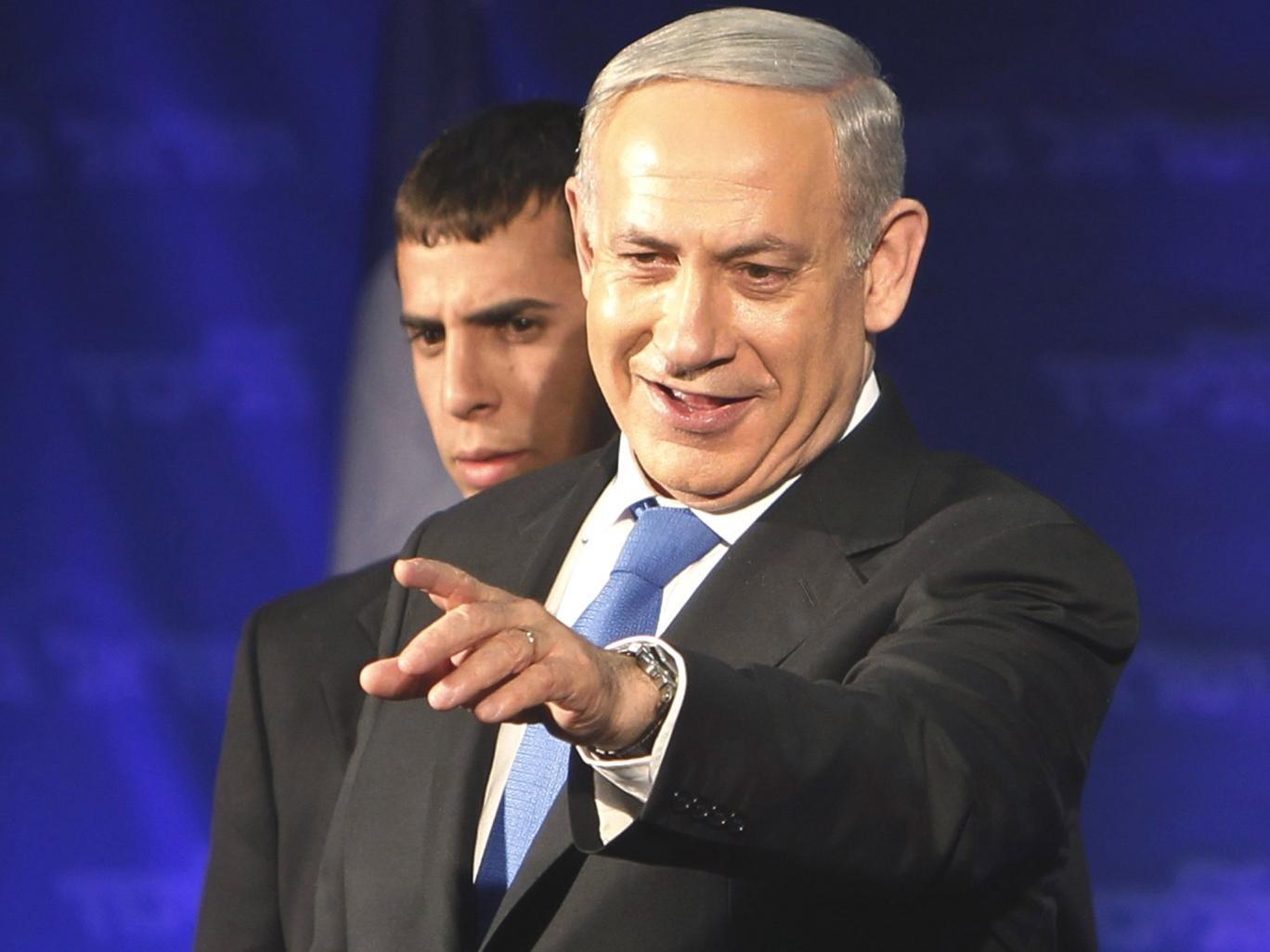 Benjamin Netanyahu celebrates in Tel Aviv on Tuesday night