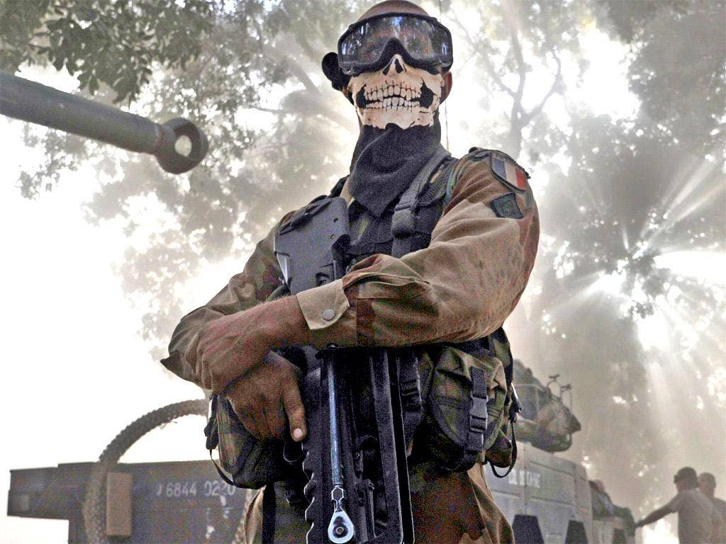 A French soldier wearing a skeleton mask in a street in Niono on Sunday