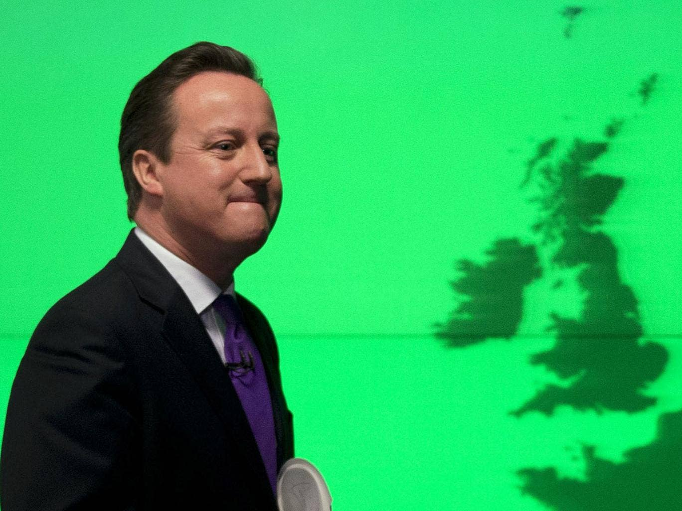 Prime Minister David Cameron walks off stage after his speech on Europe