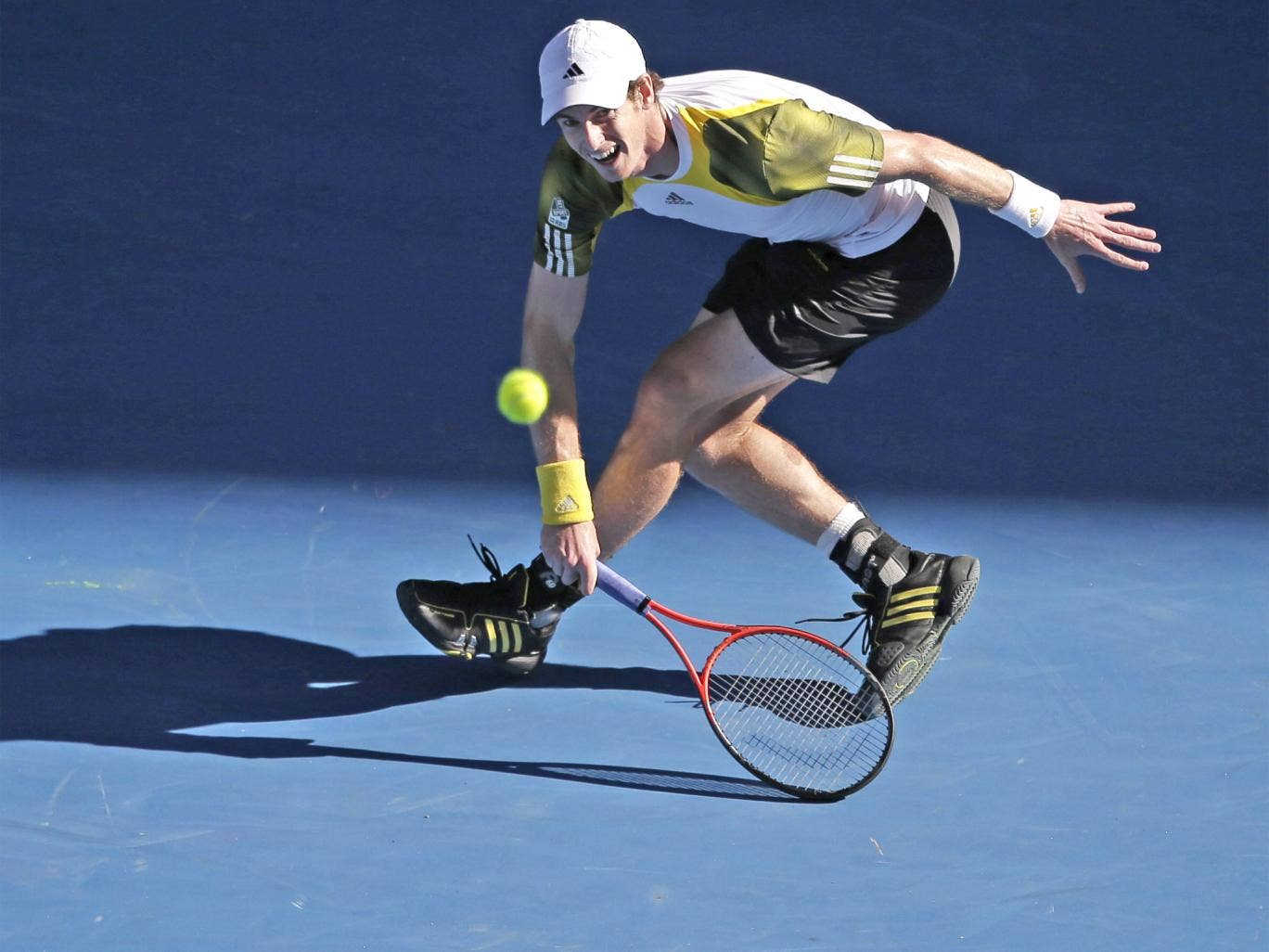 Andy Murray hits a return in his win over Jérémy Chardy