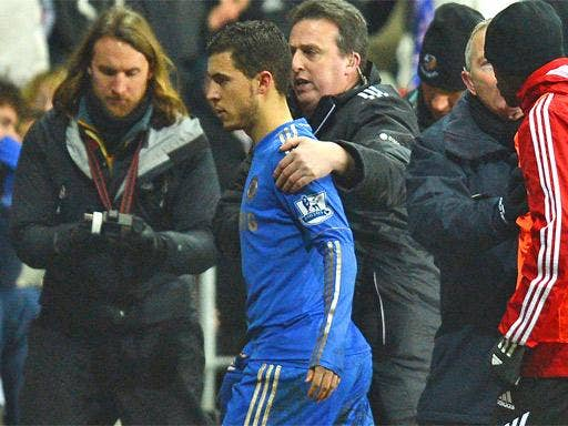 Eden Hazard is guided off the pitch