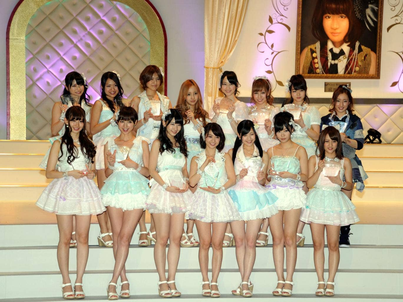 Tomomi Kasai (fourth from left, back row) is pictured with AKB48