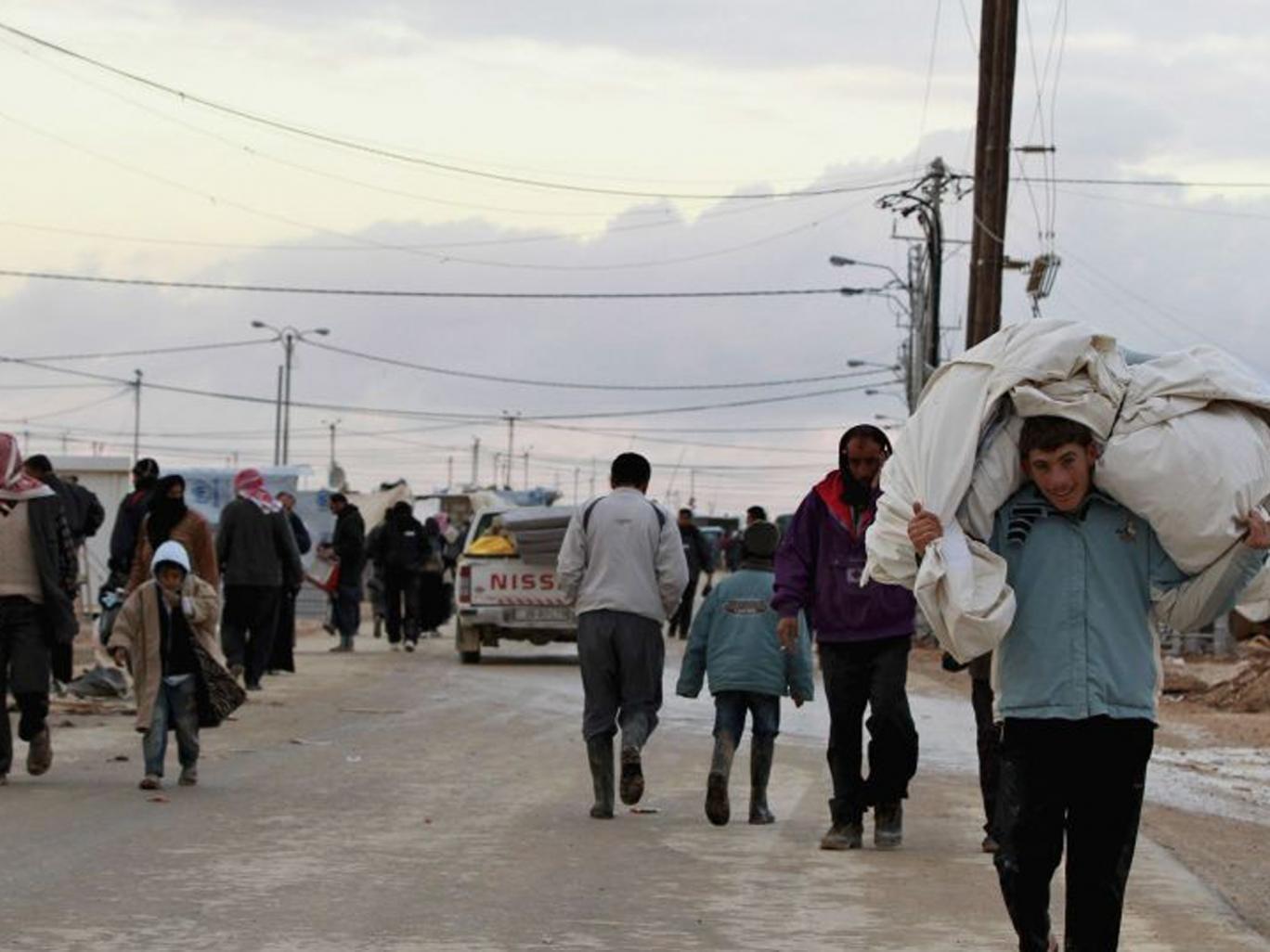 Syrian refugees at the Al-Zaatari camp in the Jordanian city of Mafraq