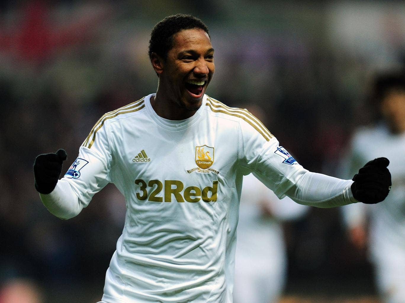 Swansea player Jonathan de Guzman celebrates after his free kick went in