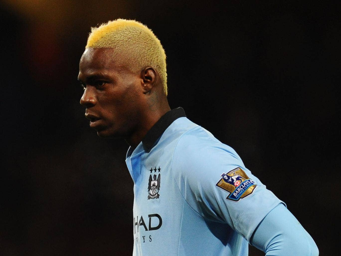 Mario Balotelli of Manchester City looks on during the Barclays Premier League match between Arsenal and Manchester City