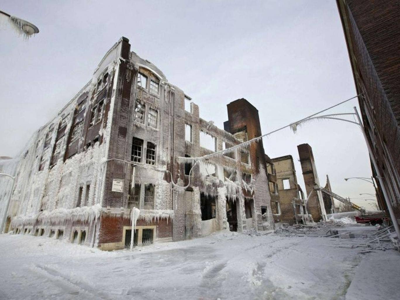 The ruins of a warehouse, still on fire, which started burning on Tuesday night are seen in Chicago January 24, 2013