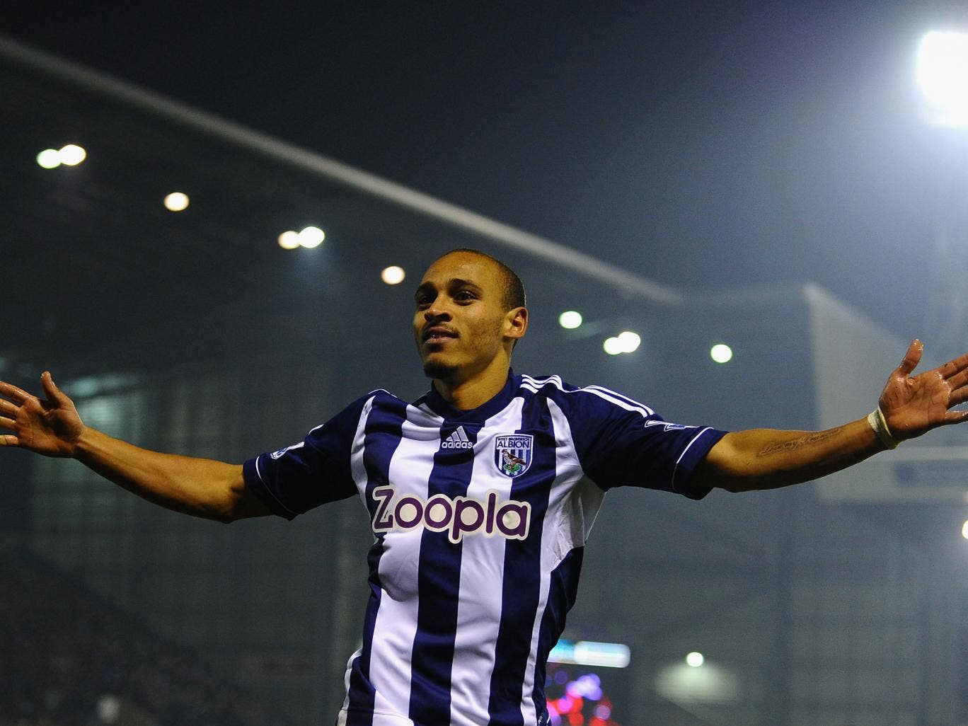 Peter Odemwingie of West Bromwich Albion celebrates scoring