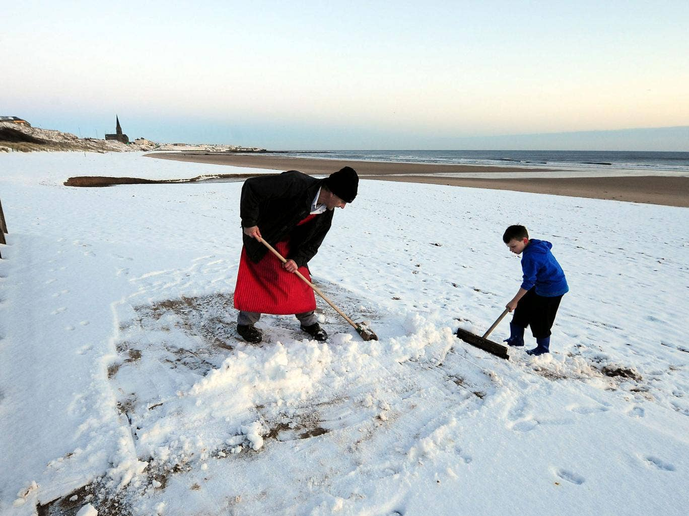 Clearing snow on Tynemouth beach, yesterday