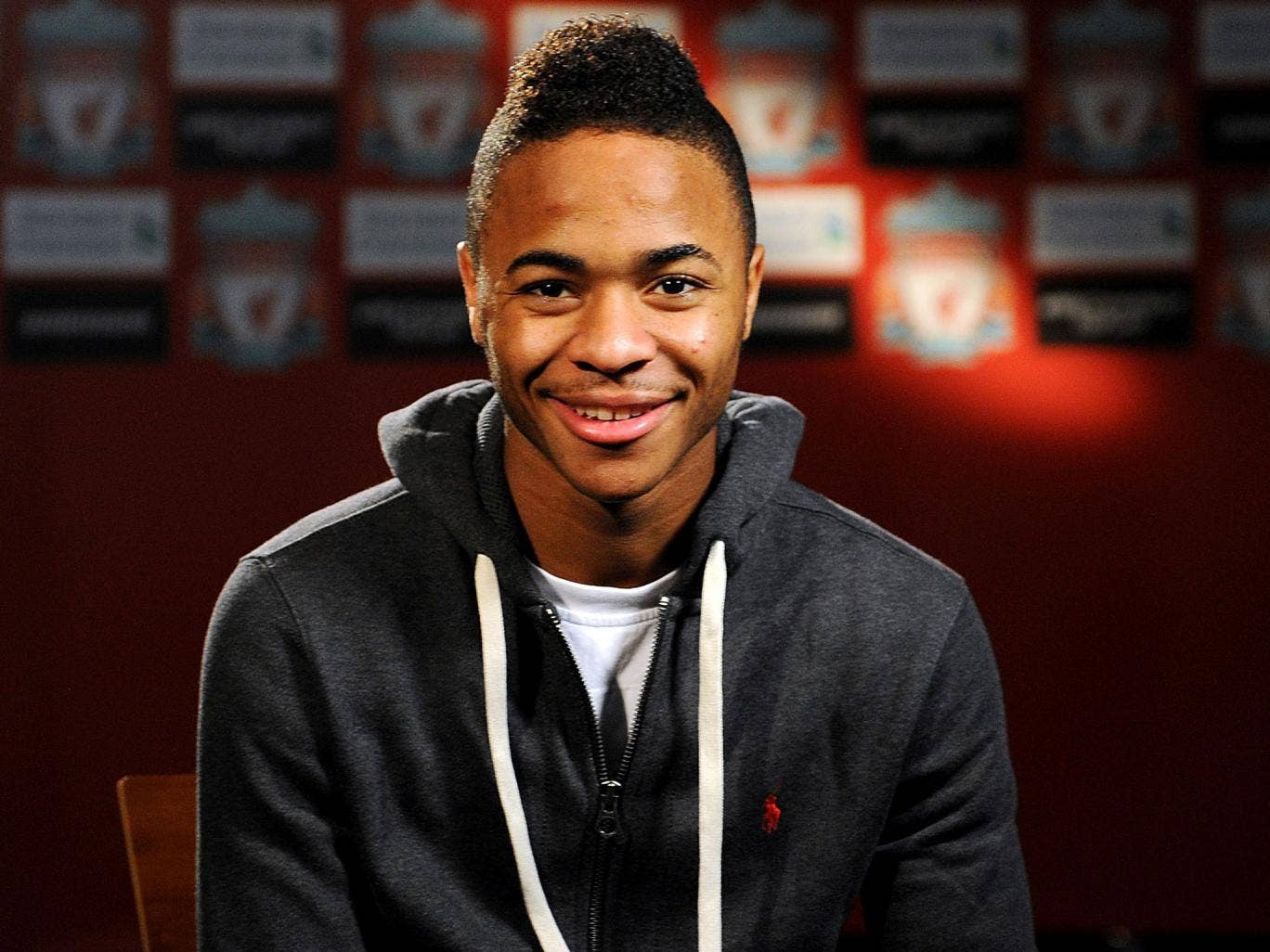 On the level: Raheem Sterling insists he will remain grounded under Brendan Rodgers at Anfield