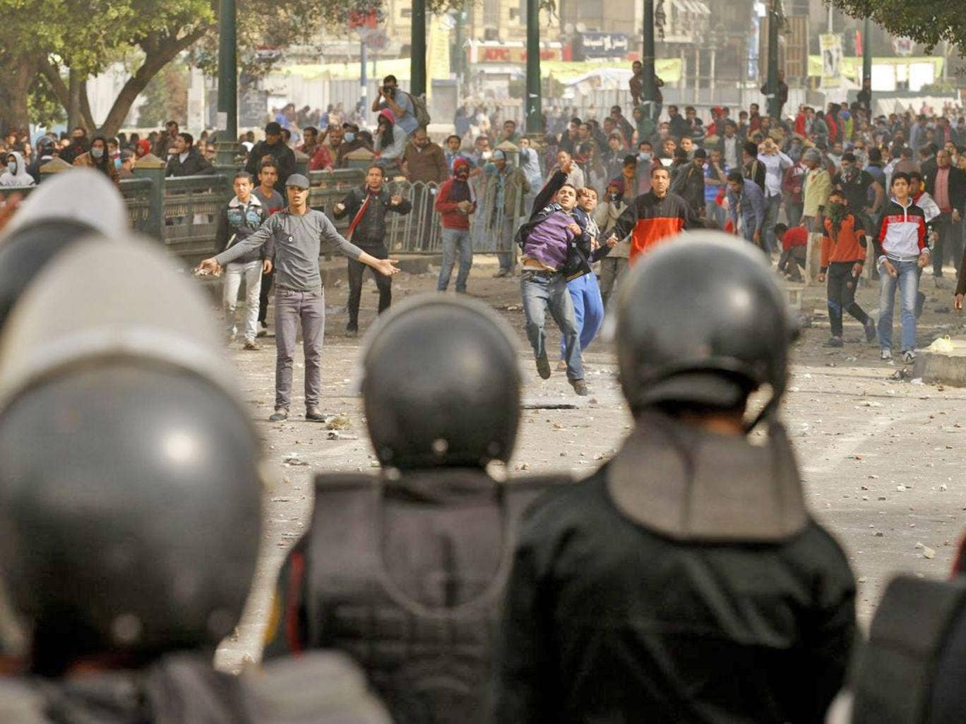 Protesters throw stones at riot policemen in Port Said