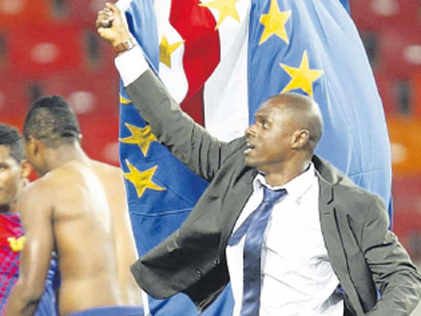 Cape Verde coach Lucio Antunes carries his country's flag