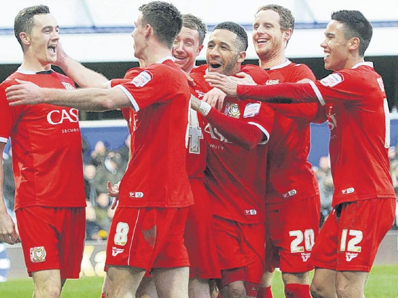 MK Dons' Darren Potter celebrates with his team-mates