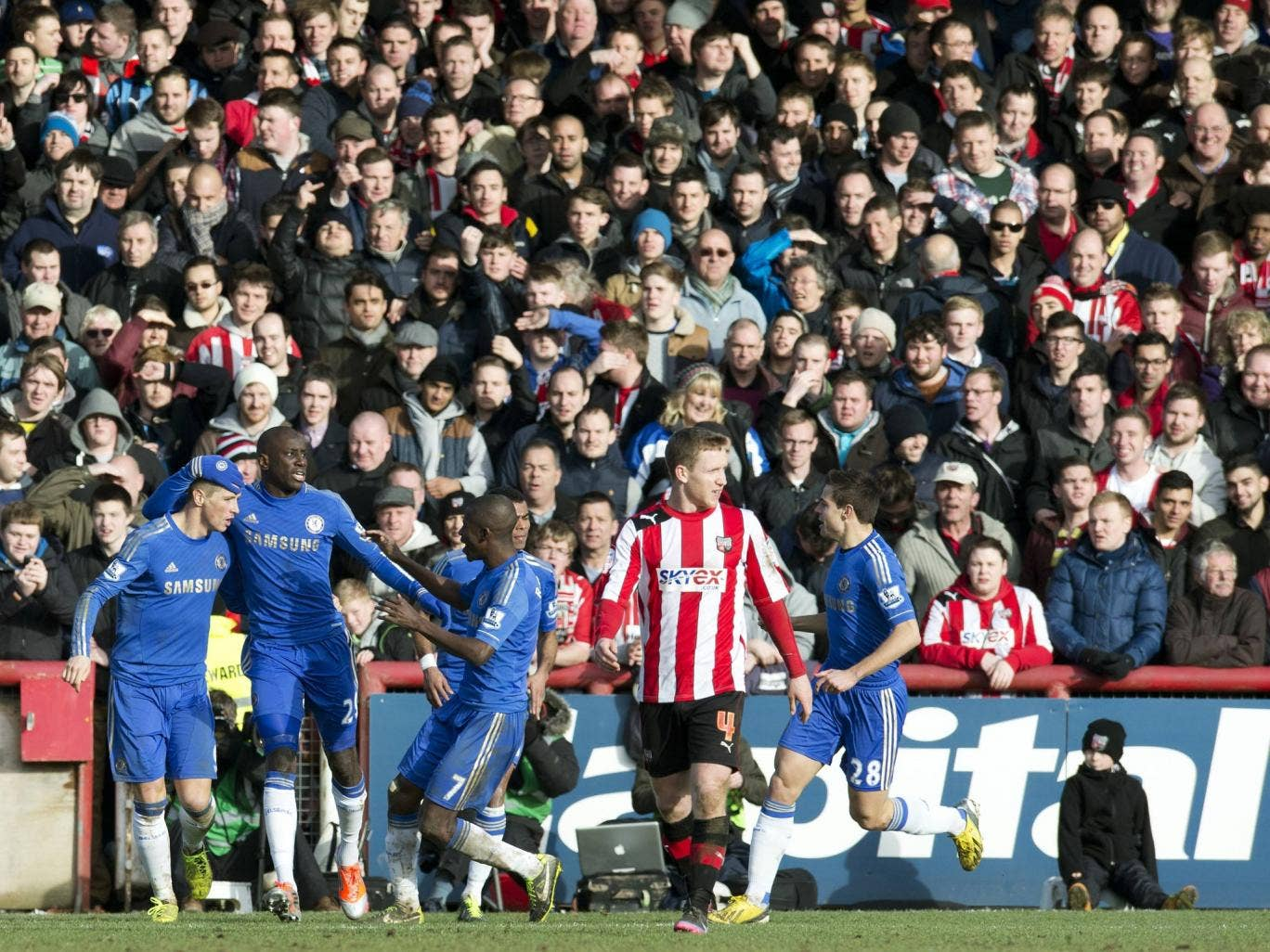 Chelsea striker Fernando Torres is congratulated for scoring in the 2-2 draw with Brentford