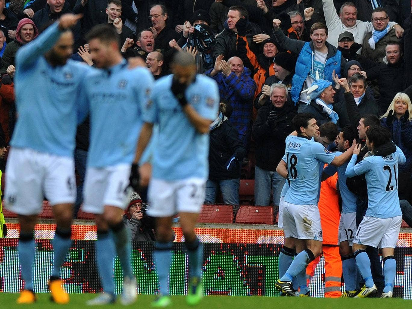 Pablo Zabaleta is congratulated on his late goal for Manchester City against Stoke
