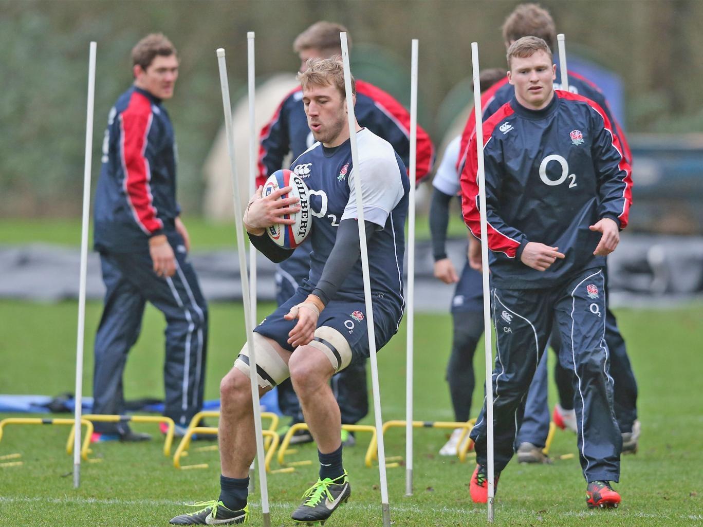 England captain Chris Robshaw shows Chris Ashton some artful dodging yesterday