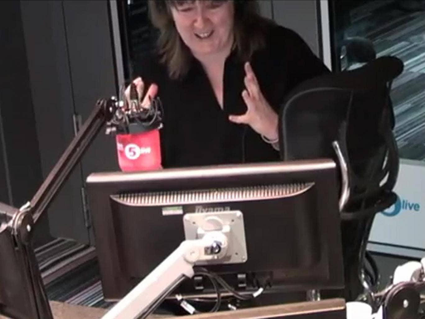 BBC 5Live presenter Shelagh Fogarty gets flustered after a mouse in spotted in the studio