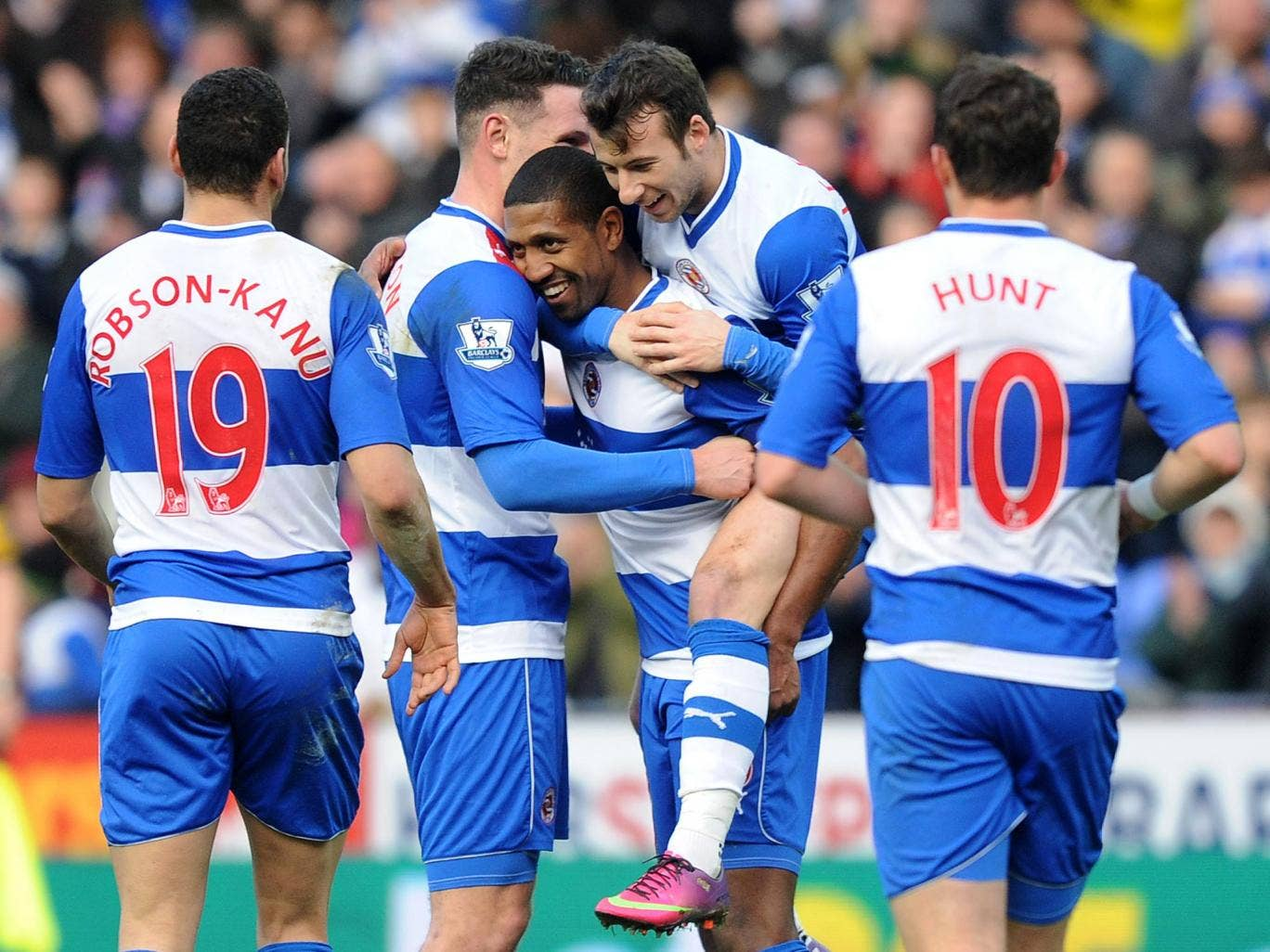 Mikele Leigertwood of Reading celebrates with team mates during the FA Cup