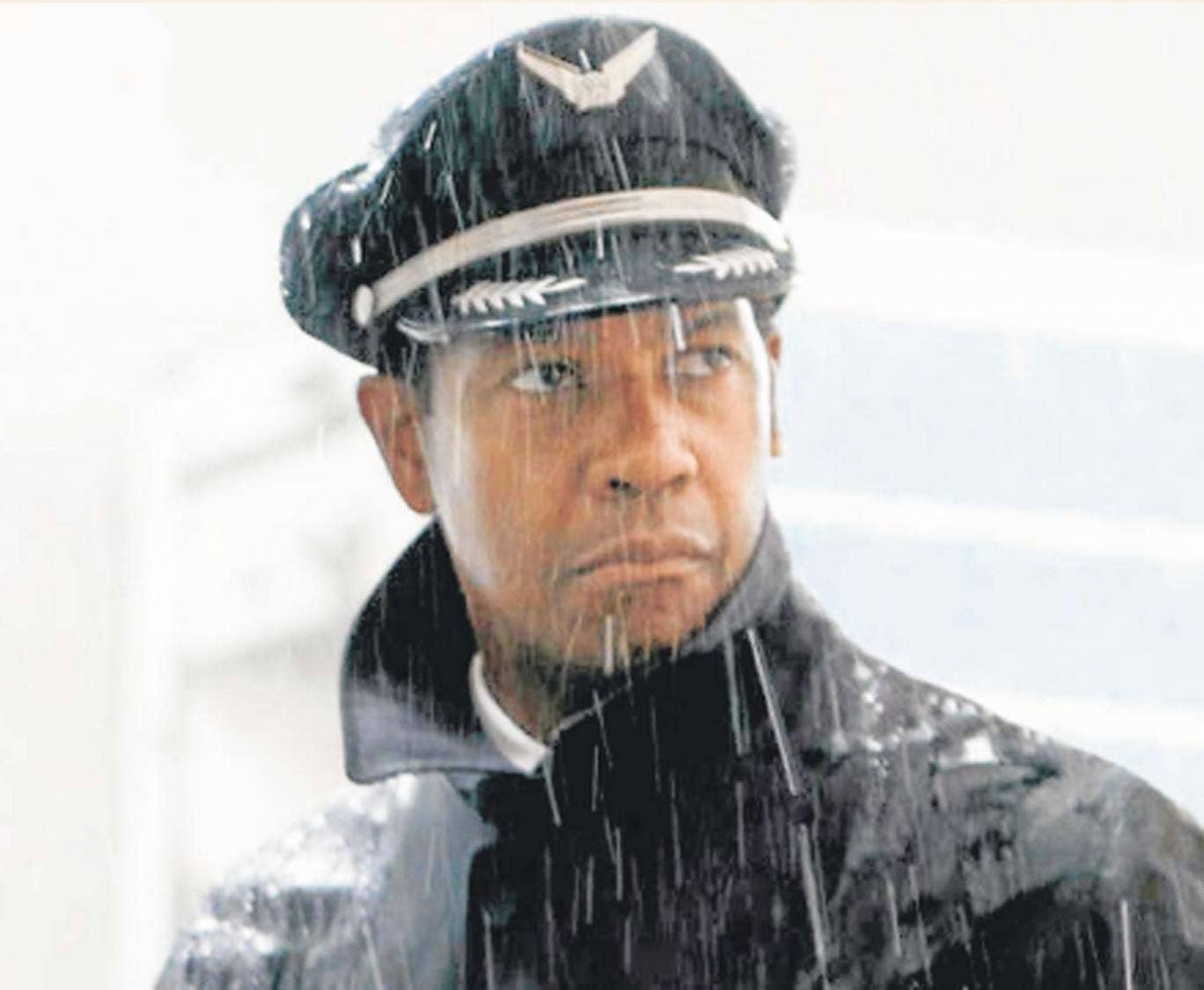 Raining day: Denzel Washington stars as an alcoholic and drug-fuelled airline pilot in the drama 'Flight'