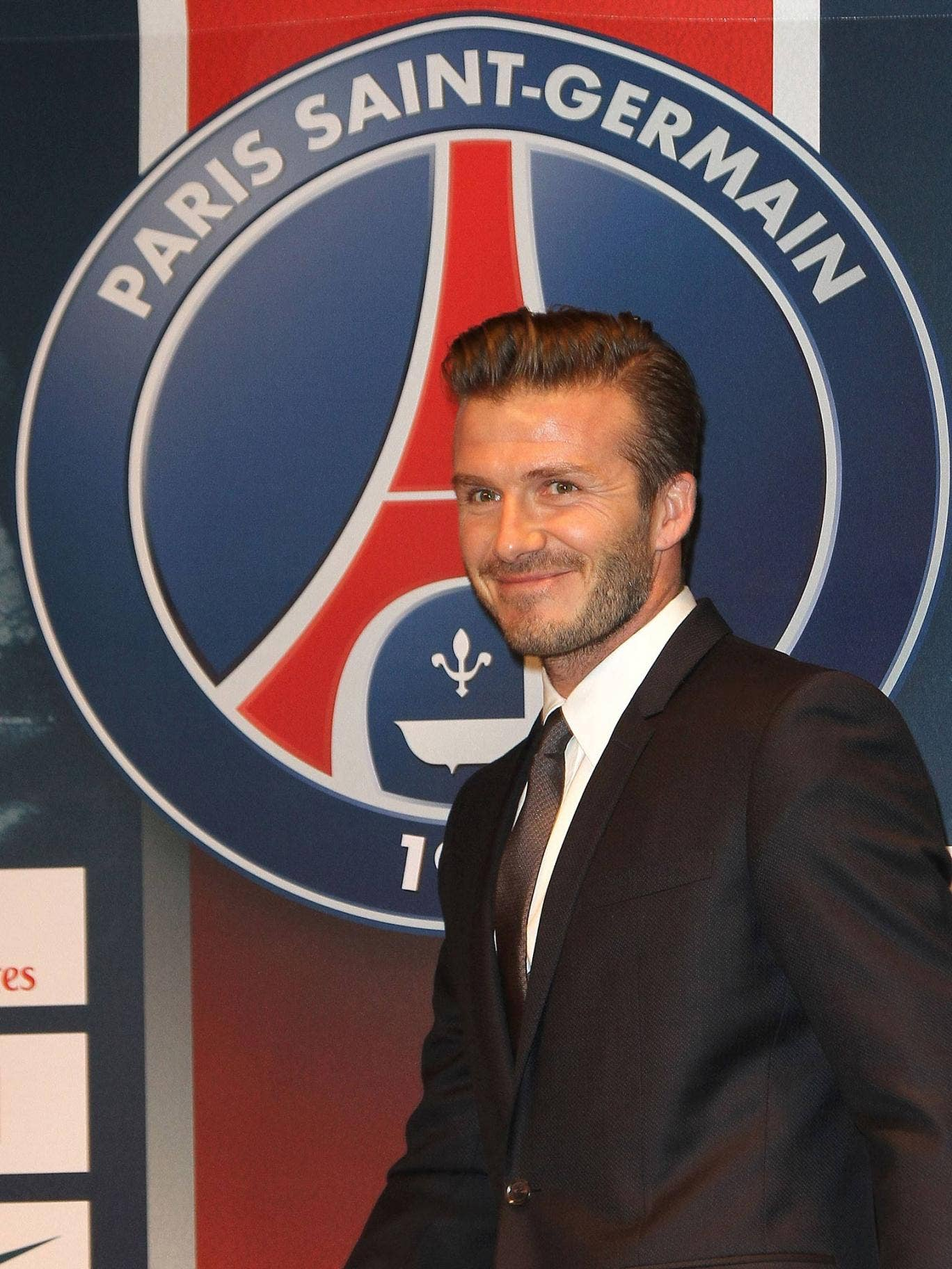 David Beckham addresses the media in Paris after completing his deal to PSG