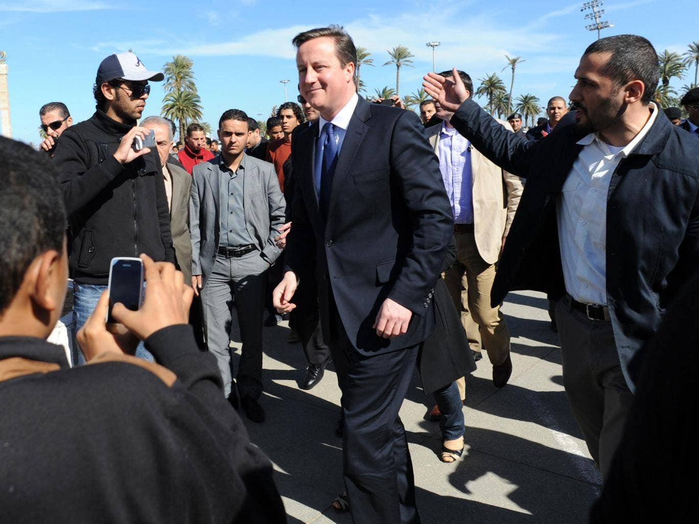 Prime Minister David Cameron takes a walk through Martyrs Square