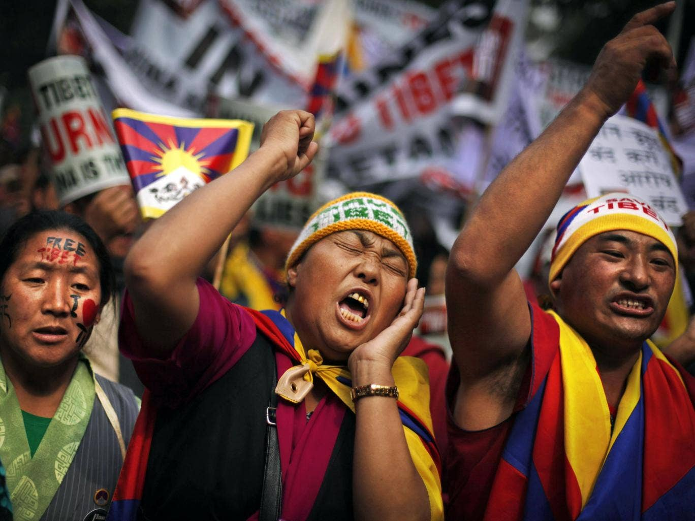 Exiled Tibetans show their support at a rally in Delhi yesterday