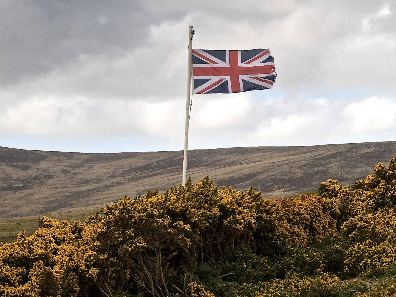 The Union Jack flying over the British War Cemetry at San Carlos in the Falkland Islands