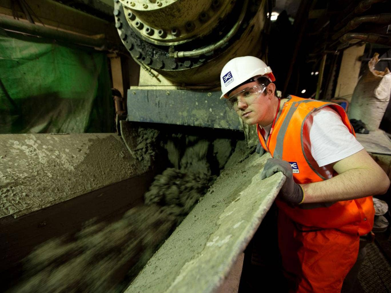 Reporter Rob Hastings watches the excavated 'muck' begin its journey down the conveyor belt