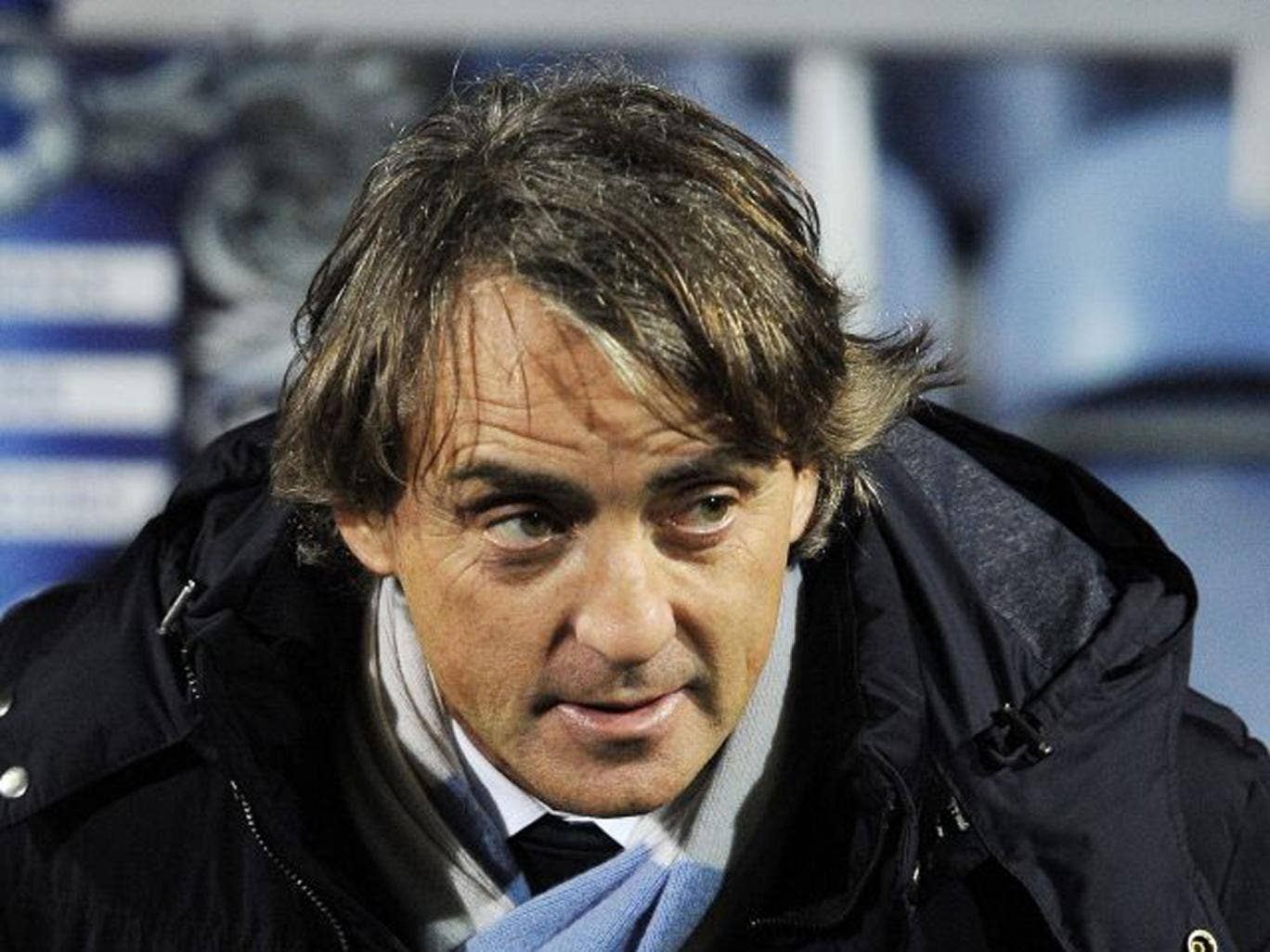 Roberto Mancini believes City will chase down United's lead