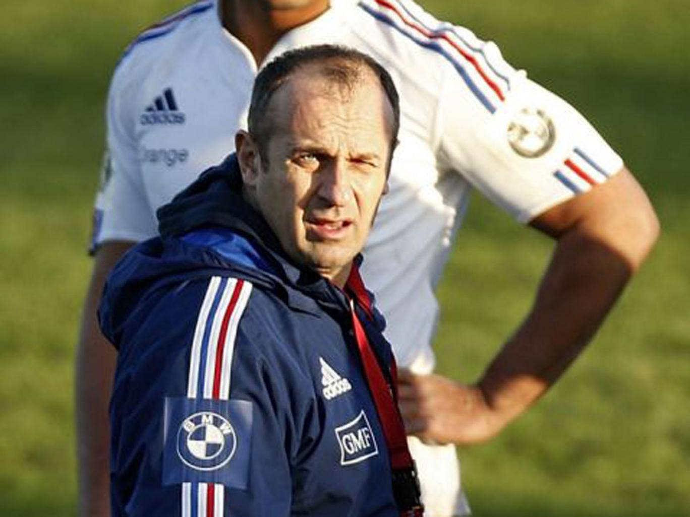 Thierry Dusautoir (back) and coach Philippe Saint-André at a France training session yesterday