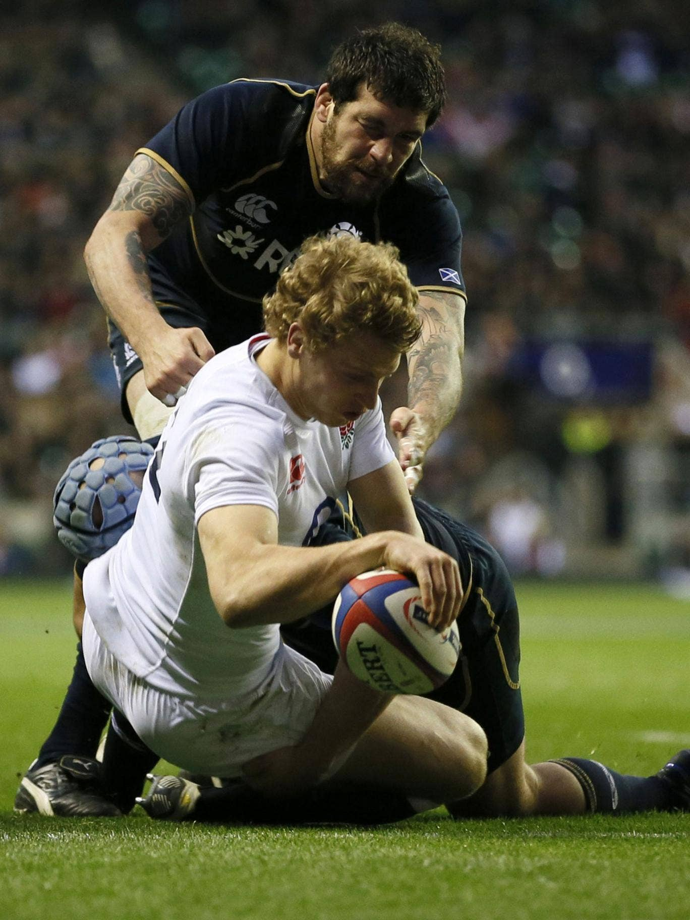 Billy whizz: Billy Twelvetrees crosses the line for the second of England's four tries to cap an impressive debut