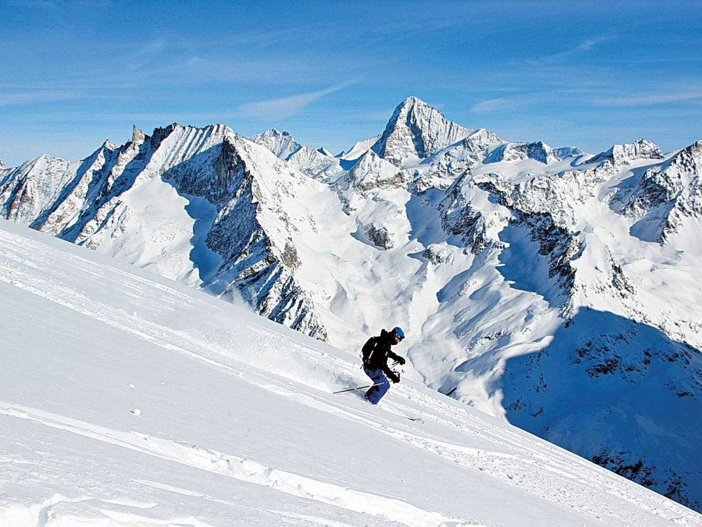 It's downhill from here: Simon skiing from the summit of the Pigne d'Arolla, accessed via a 10-minute helicopter ride from Grimentz (Image: Felix Milns)