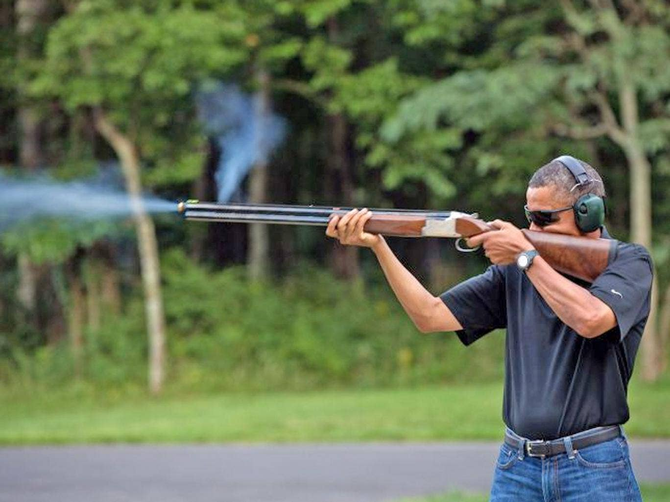 President Barack Obama shoots clay targets with a shotgun on the range at Camp David, Maryland. Obama has put forth great effort to pass legislation to ban assault rifles in the wake of the Newtown
