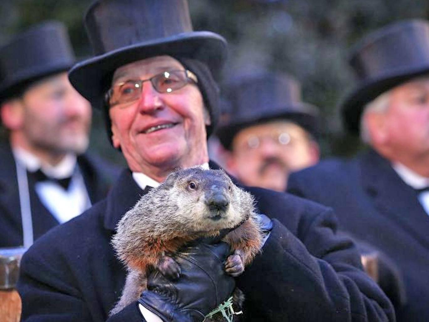 Co-handler Ron Ploucha holds Phil, the weather prognosticating groundhog during the Groundhog Day celebration at Gobblers Knob in Punxsutawney, Pennsylvania, USA