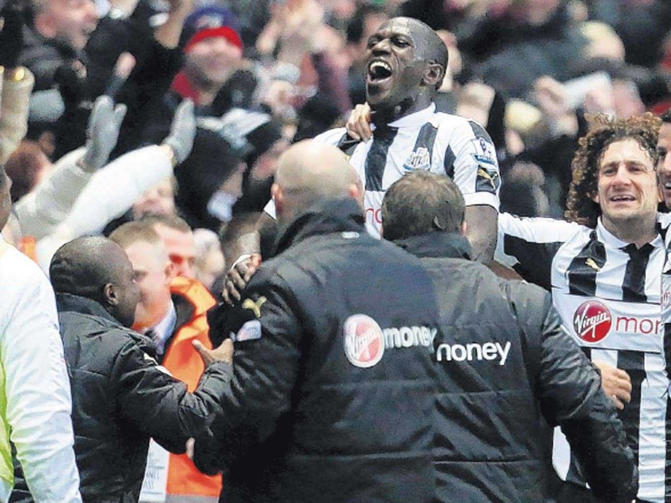 Moussa Sissoko is mobbed by his Newcastle team-mates on Saturday