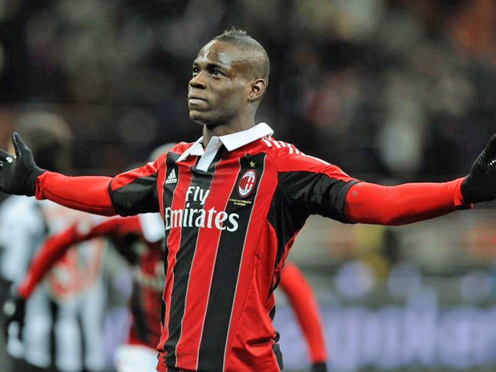 Mario Balotelli celebrated his Milan debut by scoring twice in a 2-1 win over Udinese last night