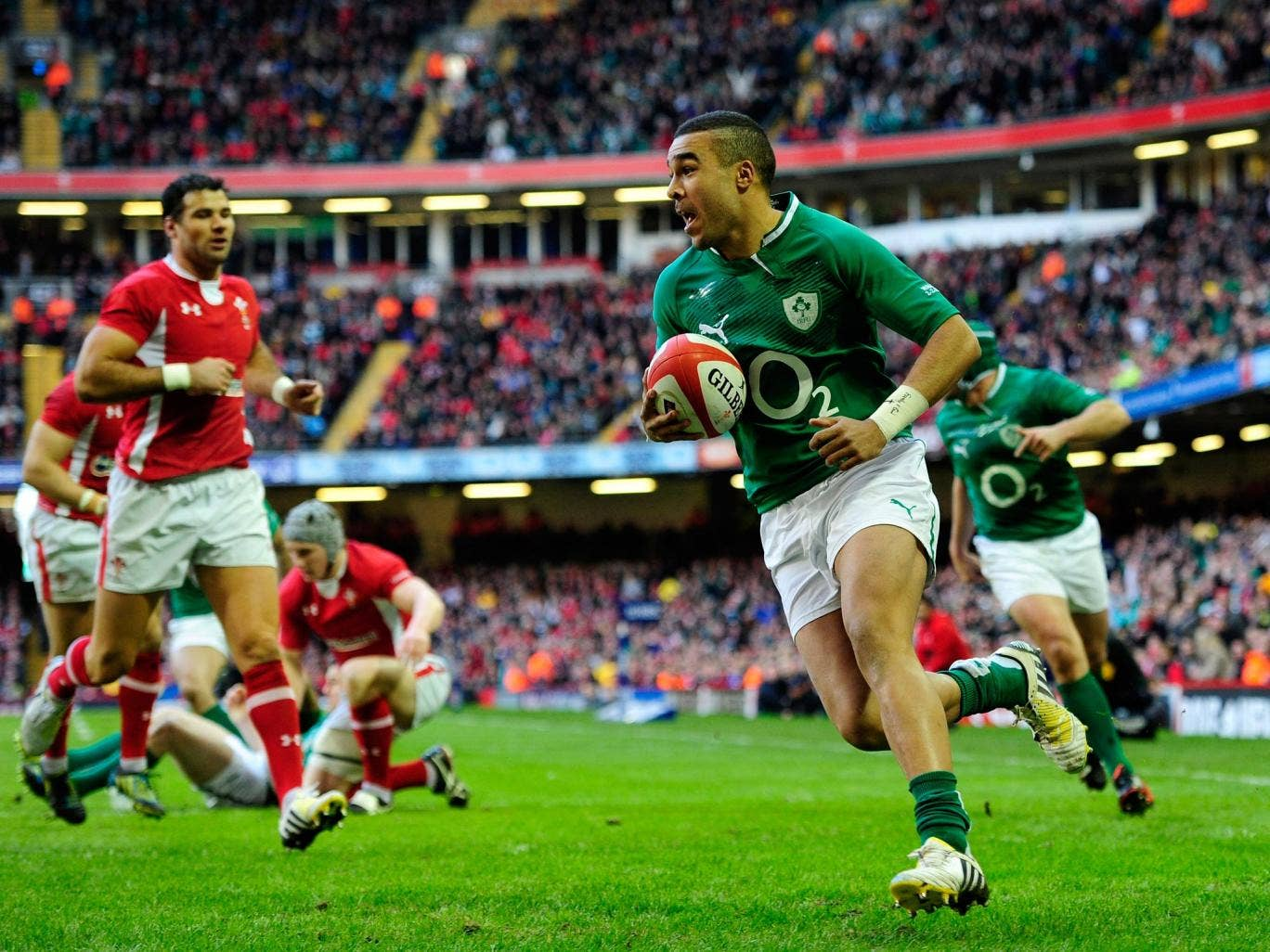 Ireland wing Simon Zebo runs in the first try against Wales