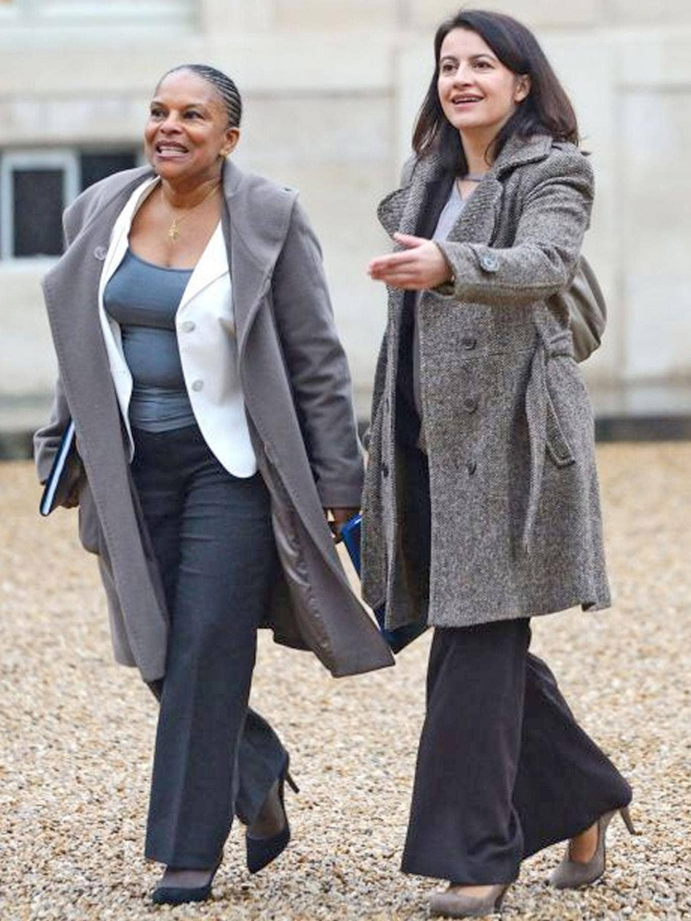 French ministers Cecile Duflot, right, and Christiane Taubira at the Elysee Palace on Sunday – in trousers