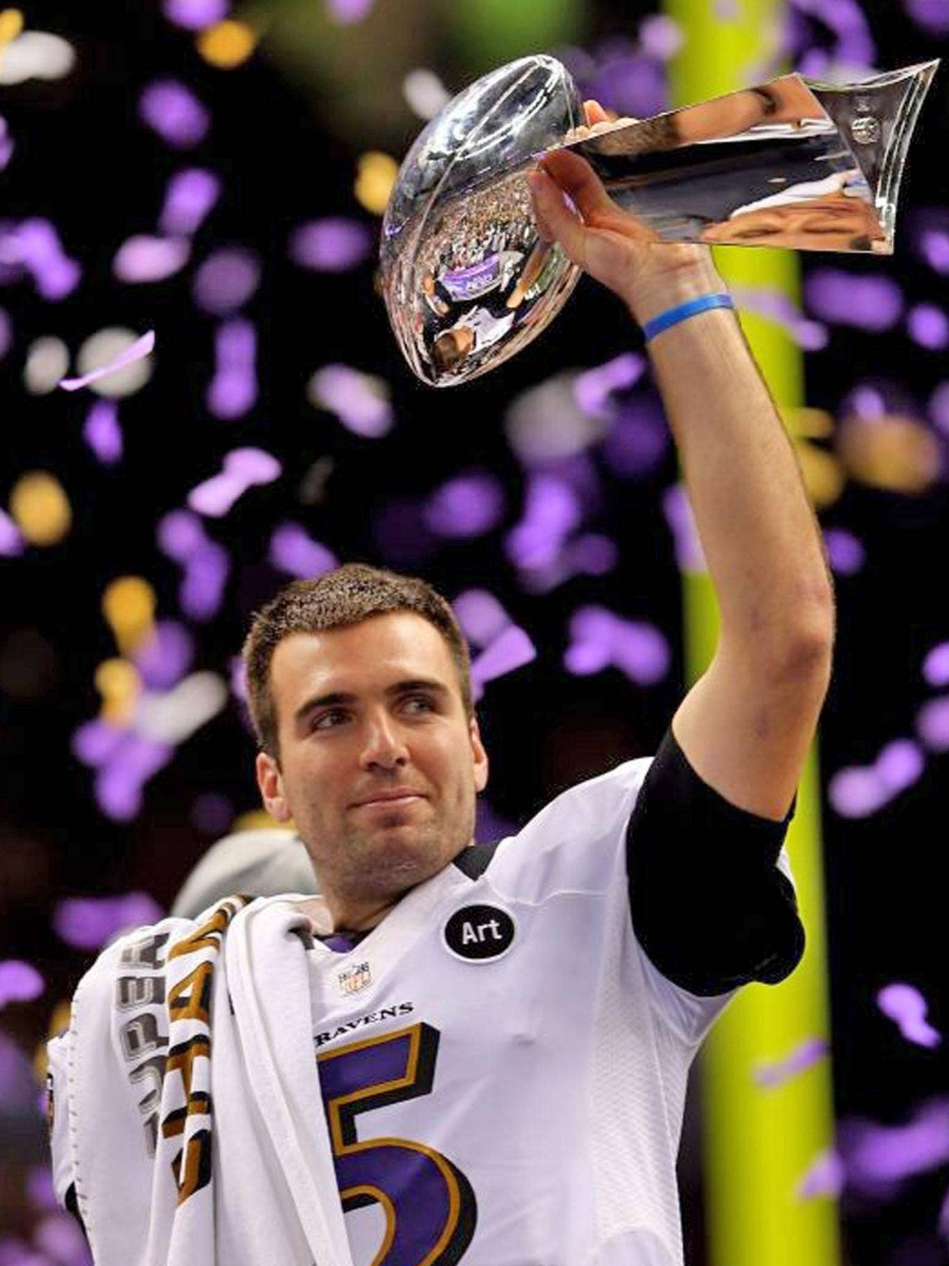 Baltimore quarterback Joe Flacco gets his hands on the Vince Lombardi Trophy