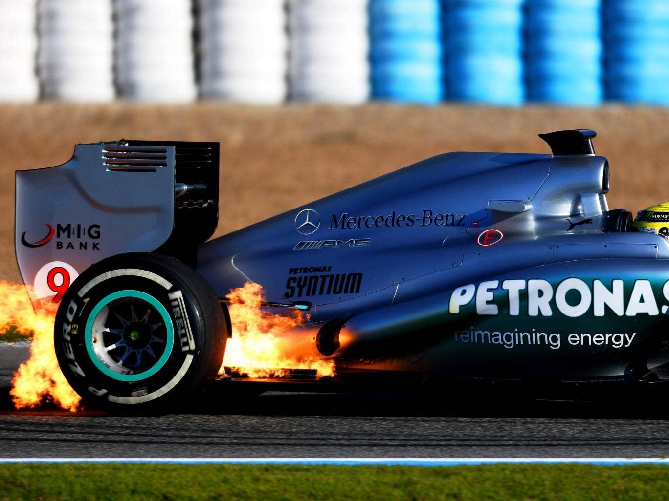 Flames seen at the back of Nico Rosberg's Mercedes