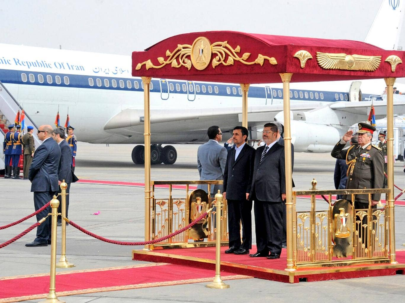 President Ahmadinejad, centre, with President Morsi