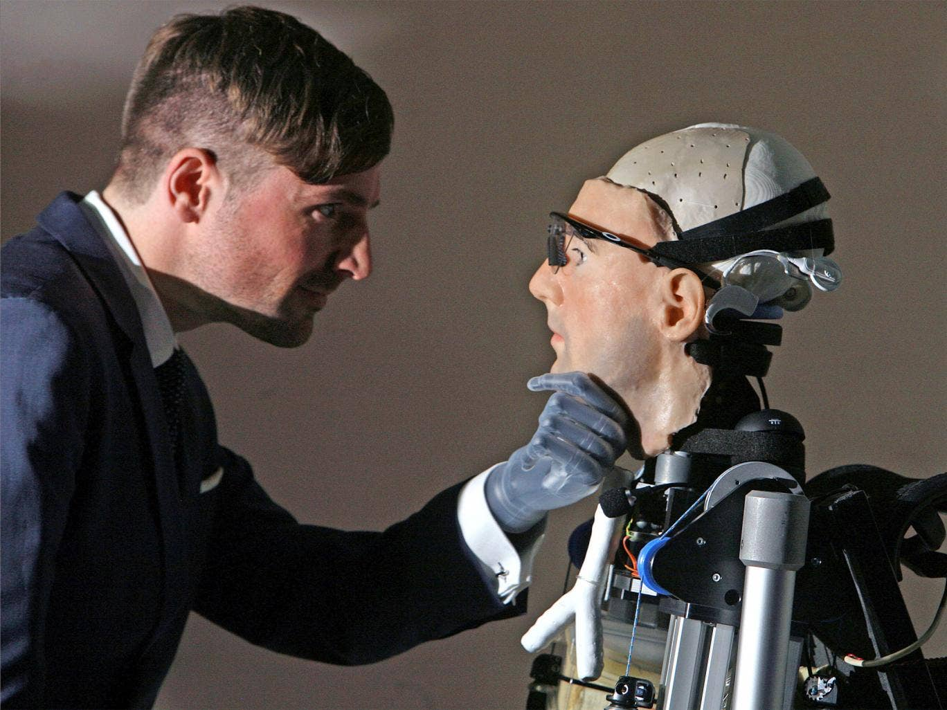 Documentary maker Bertolt Meyer (who has a bionic hand) is pictured examining 'Rex'