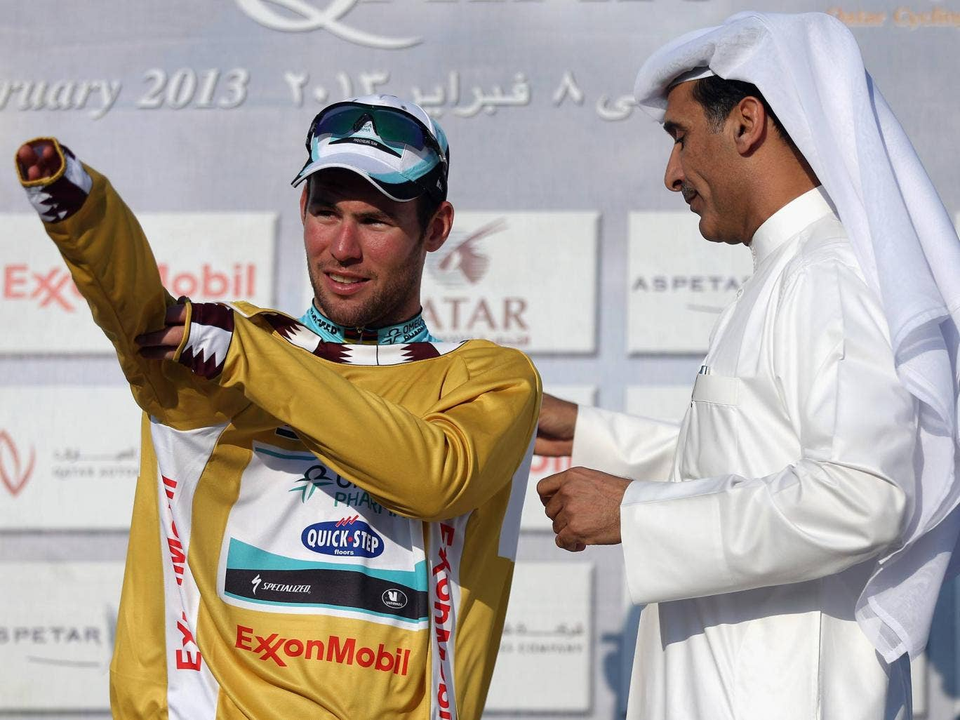 Mark Cavendish tries the Tour of Qatar golden jersey on for size