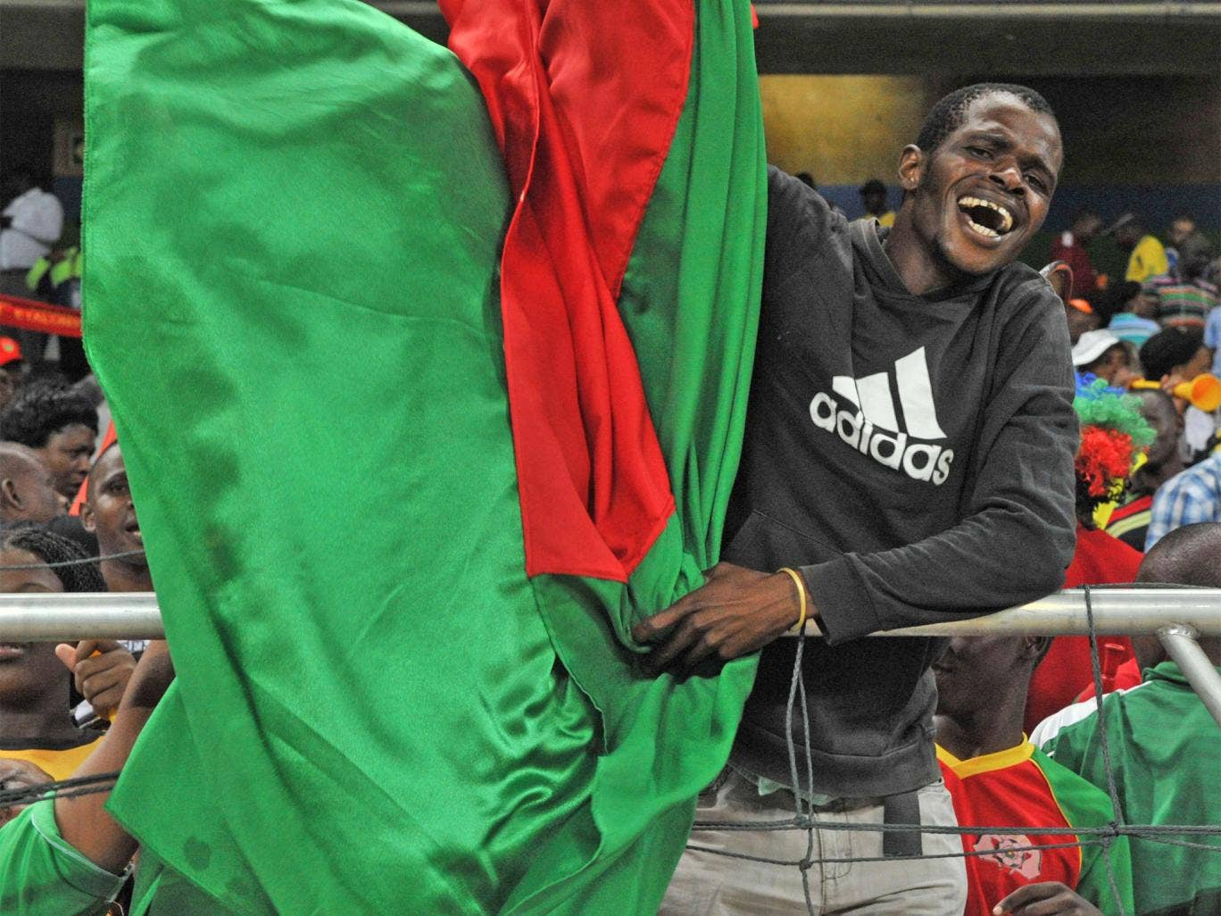 A Burkina-Faso supporter celebrates following their shootout victory