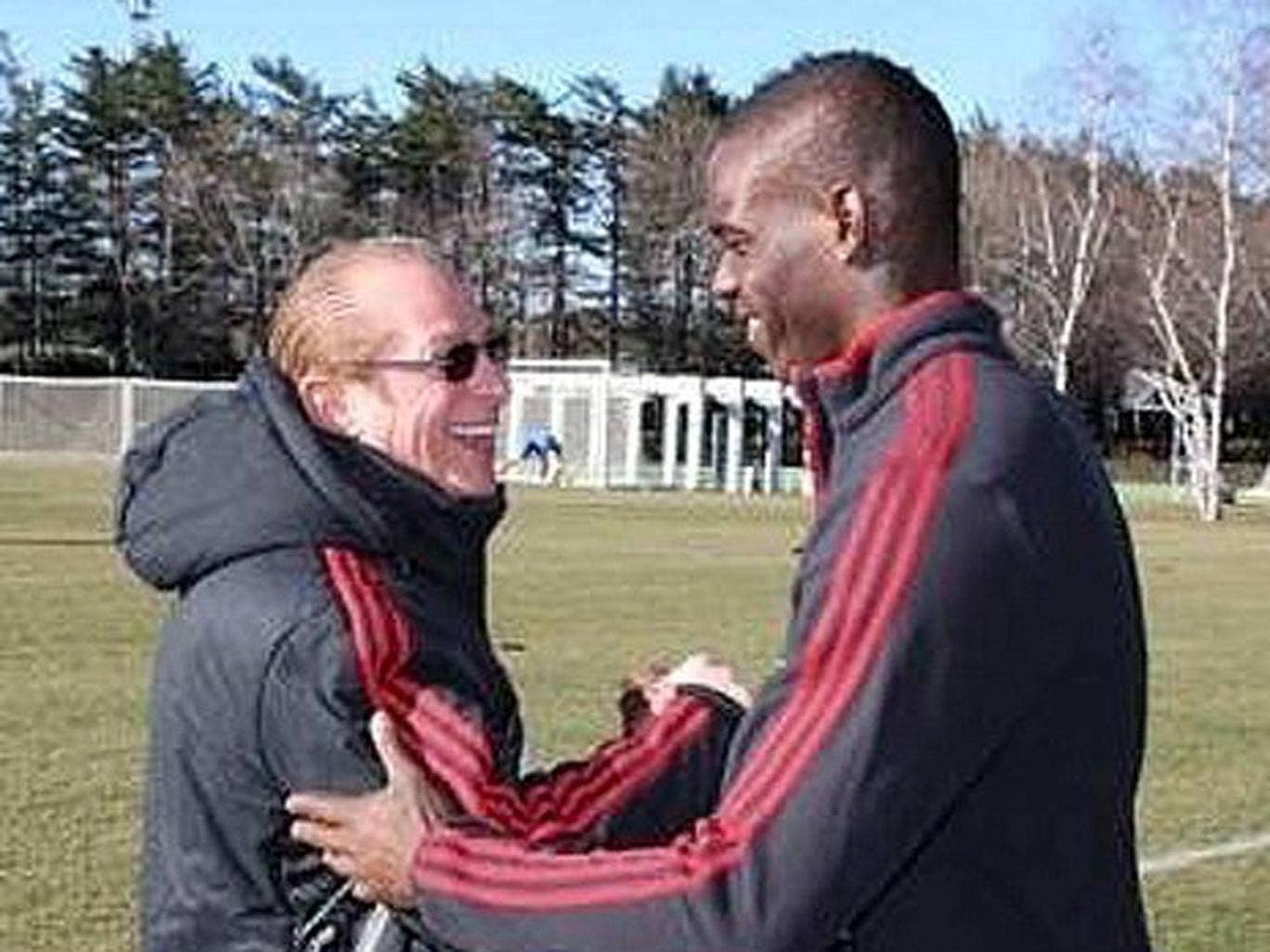AC Milan released this picture, appearing to show Paolo Berlusconi making peace with Balotelli