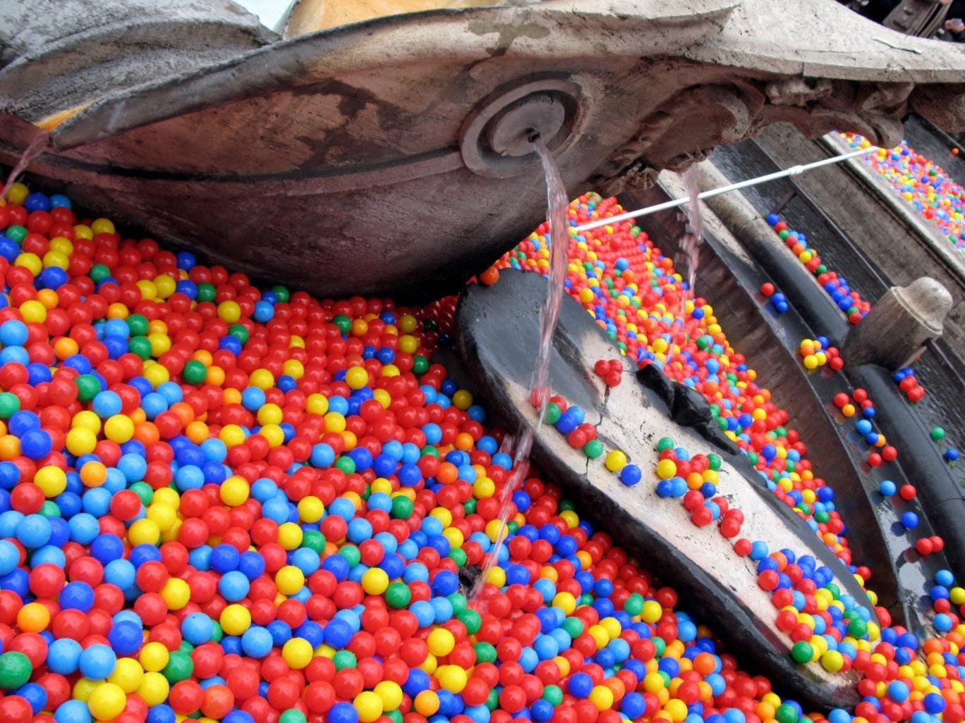 Graziano Cecchini unleashed colourful balls into Rome's Trevi Fountain